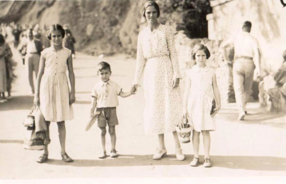 The three children with their mother Amy at the seaside, about 1932