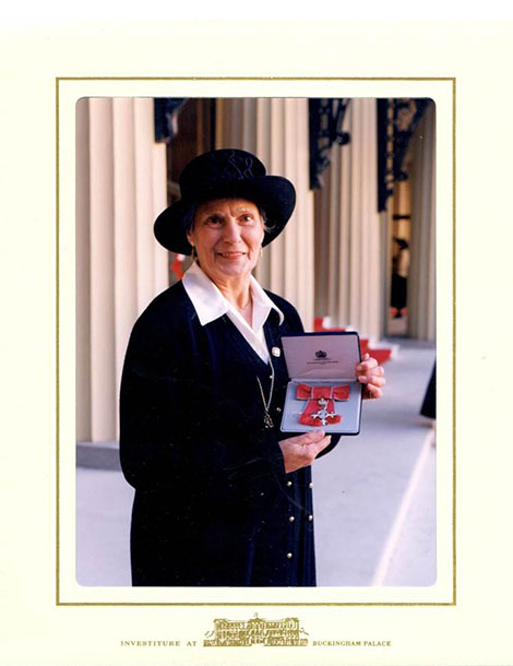 Helen receiving the MBE in 1997 (Photo by Charles Green, 309 Hale Lane, Station Road, Edgware, Middlesex HA8 7AX)