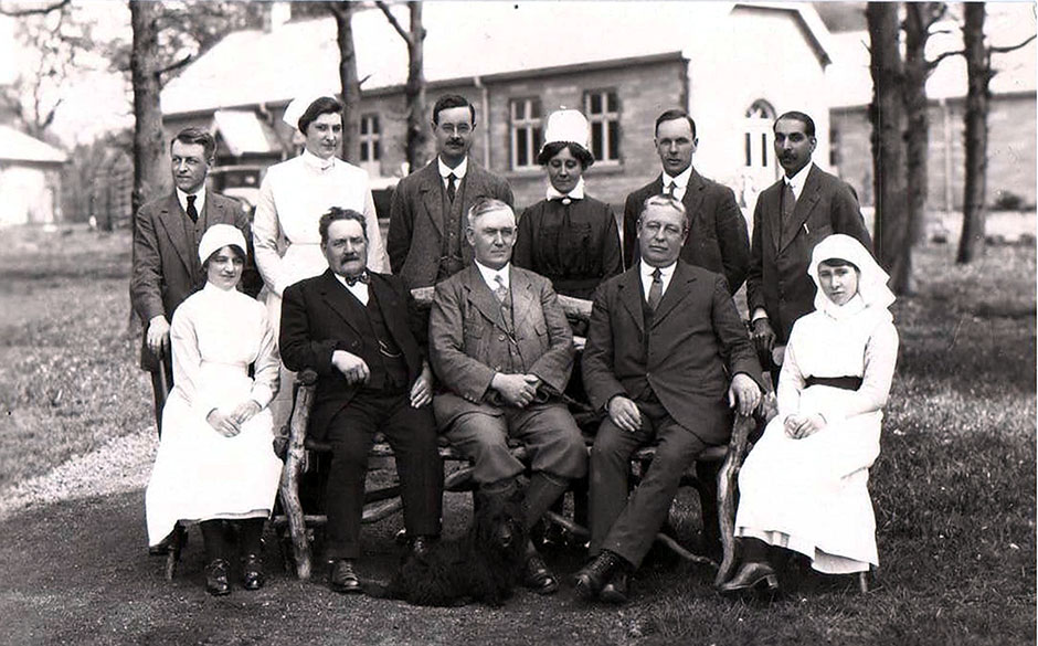 This photograph of the Dilke Hospital is in the Helen Kegie Collection, but we cannot be certain that it was taken by Alfred or that it was definitely taken at the opening.  The doctor on the right is Dr Bangara who died in 1927, so this is certainly an early photo of the hospital.  (We are grateful to Averil Kear of the Forest of Dean Local History Society for her help with identifying this photograph)